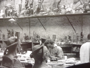 A detail from inside the model room at Singers, showing the skilled craftsmen working on models and finishing off pieces. Many of the Singers workforce had been educated at the Frome Art School, opened by John Webb Singer in 1865, before serving their apprenticeship at the works. Note all the wonderful plaster cast models, sadly now destroyed or missing. Printed from the original glass plate negative.