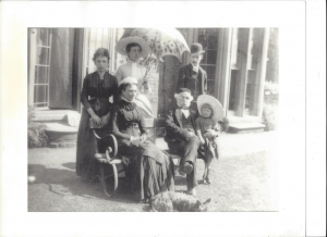 Camille Claudel (on the left) with members of the Singer family, in front of North Hill Cottage, Frome, 1886. Seated with Singer are his wife Sarah and granddaughter Beryl, and standing behind him, his son Walter Herbert and his wife Kate