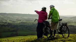Couple enjoying a view while cycling