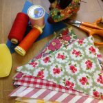 Sewing equipment for bunting laid out on a table