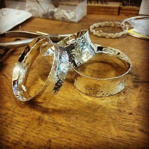 metal bangles on bench