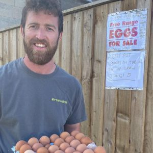 Man holding tray of hens' eggs