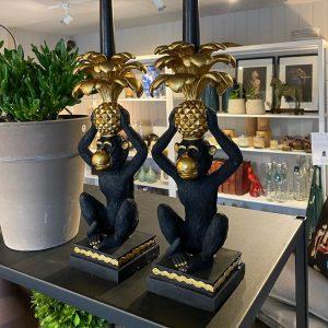 Monkey candlesticks in shop display