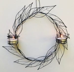 wire artwork with candles