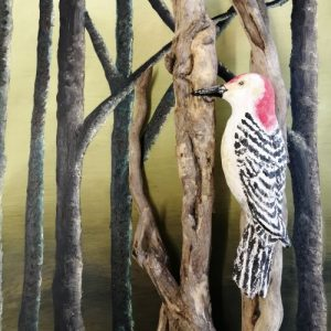 Wooden sculpture of woodpecker