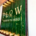 'Flow - the bar on the bridge' sign