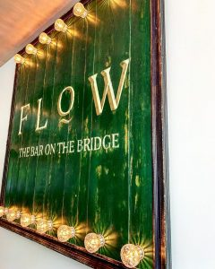 'Flow - the bar on the bridge' sign