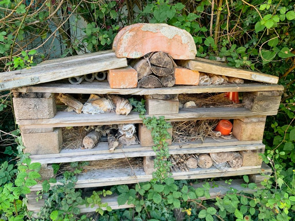 photo of large bug hotel, instructions below