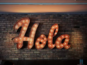 """Hola"" spelled out in light bulbs"