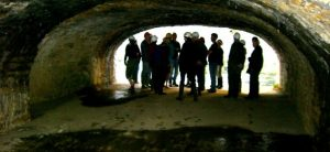 Group of people standing in a tunnel