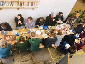 People sitting around a table eating