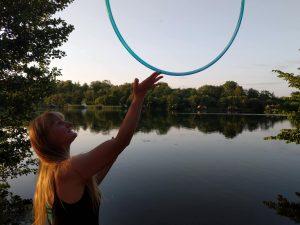 lady balance hula hoop on finger