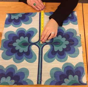 A cushion cover being measured