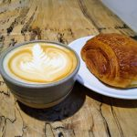 Cup of coffee and a pastry